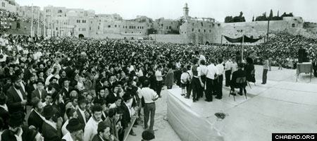 Thousands celebrate the completion of the first Children's Torah Scroll at the Western Wall in Jerusalem.