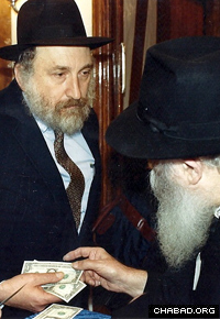 Yaacov Hanoka, left, treasured the advice he received from the Rebbe, Rabbi Menachem M. Schneerson, of righteous memory.