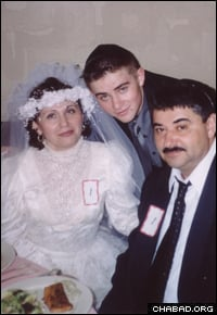 Avrohom (Alexander) Denisov with his parents at their Jewish wedding