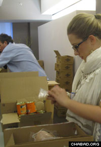 The boxes of food include canned fruits and vegetables, and other sundry items.