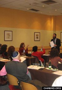 Rabbi Mendel Hendel leads a class at Chabad-Lubavitch of Athens.