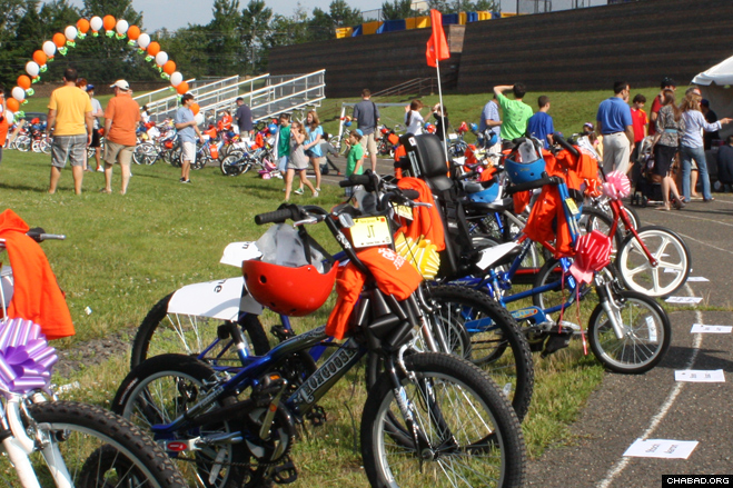 Volunteers line up a fleet of specially-designed bicycles to be given to 100 local children with special needs as part of Olivia's Friendship Cycle.
