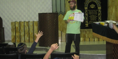 Learning comes alive as Lipa leads an interactive Torah workshop.