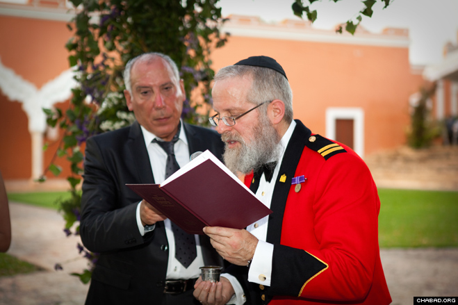 """Canadian Capt. Rabbi Lazer Danzinger officiates at the wedding of Maj. Alain Cohen and Alexi Haligua-Cohen in full military dress uniform. """"Although I feel it is a privilege to care for all soldiers, regardless of their religious background,"""" said a thrilled Danzinger, """"it was the spiritual welfare of Jewish soldiers such as Alain that motivated me to join the Canadian Forces in the first place."""""""