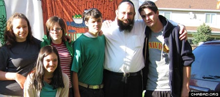 Rabbi Benny Zippel, second from right, directs Chabad-Lubavitch of Utah and its Project HEART, a program that provides Jewish connections to children in residential treatment centers.