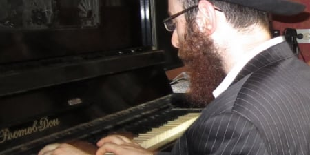 The happy sounds of Syem Sorok—a popular Jewish-Russian song—filled Lyuba's home.
