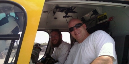 Eric also flies a helicopter to save lives. Eric and Eli enjoying a moment aboard a rescue chopper.