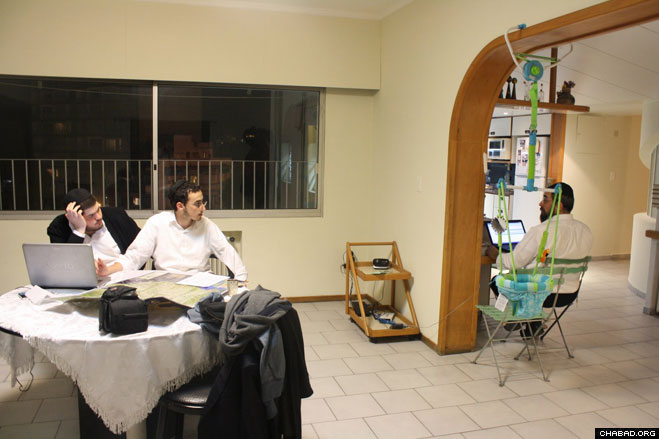 Rabbinical students Yisroel Aryeh Leib Schmuckler and Meir Shemtov discuss their route through the country with Rabbi Eliezer Shemtov, the Montevideo-based director of Chabad of Uruguay.