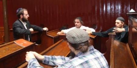 A roving rabbi gives a Torah talk in the Cork synagogue.