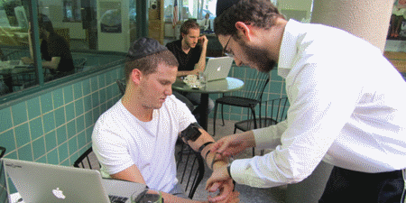 Raz in tefillin for the first time.