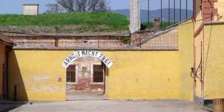 """The cynical words posted above the entrance to the concentration camp read, """"Work makes free."""""""