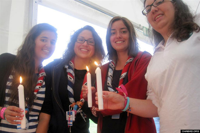Jewish Girl Scouts from around the world took the opportunity to light Sabbath candles towards the end of the World Scouting Jamboree held this summer in Rinkaby, Sweden.