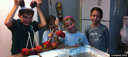 Jewish children in Puerto Rico make candied apples at the local Chabad House in honor of the approaching holiday of Rosh Hashanah.