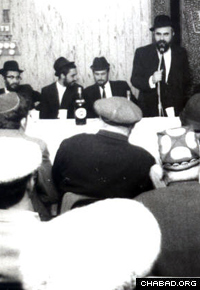 Rabbi Shalom Ber Lifshitz attends an event for immigrants in the 1980s.