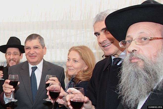 Chabad-Lubavitch of Rome director Rabbi Yitzchok Hazan, right, Union of the Centre majority leader Pier Ferdinando Casini, Edith Arbib Anav, Israeli Ambassador Gideon Meir, and Rabbi Menachem Lazar offer a Sukkot toast in the Sukkah of Peace at the Piazza Farnese.