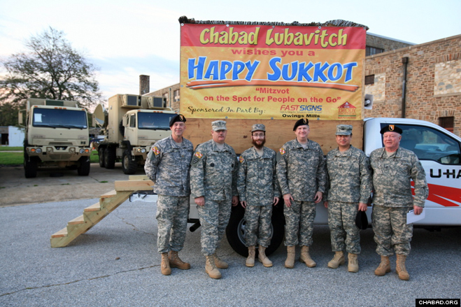 Soldiers with the Maryland Defense Force visited a mobile sukkah last week at the Pikesville Military Reservation.