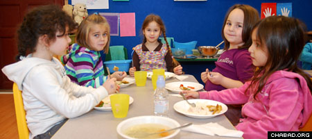 Students eat lunch at the new Beis Menachem Children's Educational Center in Budapest.