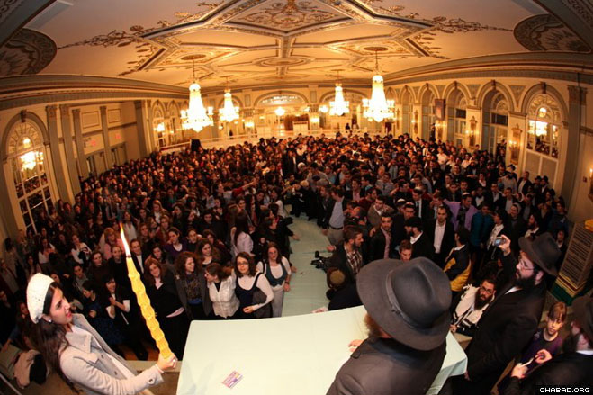 More than 800 Jewish college students from around the world fill a Crown Heights ballroom for a Saturday night Havdalah service marking the close of the Sabbath.