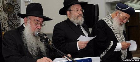 Rabbi Sholom Ber Butman, left, shown with Israeli Chief Rabbi Shlomo Amar, right, established the 32nd Chabad House in Tel Aviv.