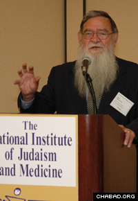 Professor Velvl Greene attends a conference on Judaism and medical ethics. (Photo: Osher Litzman)