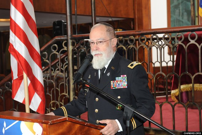 Col. Jacob Goldstein, a Chabad-Lubavitch rabbi who has served as a U.S. Army chaplain for more than three decades under a one-time exception to military grooming policy, speaks at the installation ceremony of Rabbi Menachem Stern.