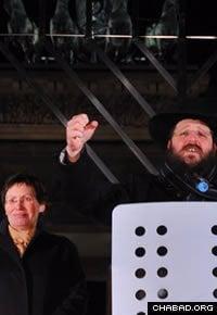 Chabad-Lubavitch of Berlin Rabbi Yehuda Tiechtel speaks at a Chanukah menorah lighting ceremony at the Brandenburg Gate in 2010.