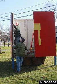 Volunteers construct the annual dreidel display in Basking Ridge, N.J.