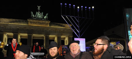 The symbolism of Germany's largest Chanukah menorah bringing light to a place that harbored such darkness was not lost on celebrants at a Tuesday night party coordinated by Chabad-Lubavitch of Berlin. (Photo: Avraham Golovacheov)