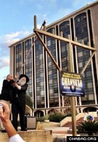 Mayor Jonathan Rothschild lights the Tucson menorah.
