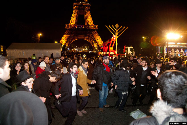 Thousands of revelers danced in the streets after the giant Chanukah menorah was lit at the Eiffel Tower.