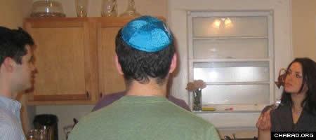 Georgia State University students enjoy a Chanukah party at the home of Rabbi Shlomo and Shifra Sharfstein.