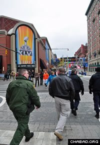 U.S. Customs and Border Protection officers and agents tour the vicinity around the site of Super Bowl XLVI. (Photo: CBP/Brian Bell)