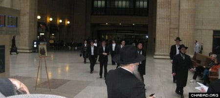 Students and rabbis from Chicago's close-knit Lubavitch community arrive at Union Station for a ceremony marking 70 years since the Sixth Lubavitcher Rebbe, Rabbi Yosef Yitzchak Schneersohn, of righteous memory, visited the city.