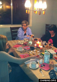 Jewish women gather around the table in Brossard, Quebec.
