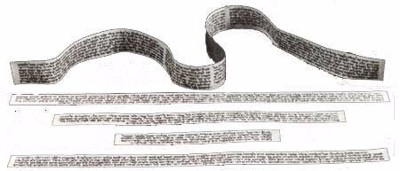 The parchment scrolls for the head and arm-tefillin.