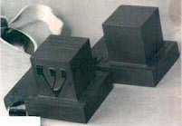 The boxes: Head-tefillin (left) and arm-tefillin (right).