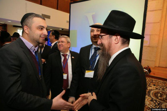 Russian Chief Rabbi Berel Lazar greets a lay leader during the Fifth Conference of the Federation of Jewish Communities of the Former Soviet Union.