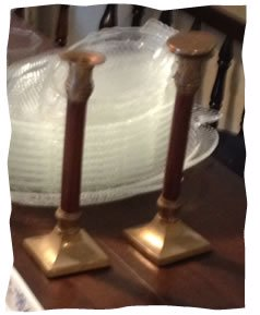 The candlesticks displayed on the table.