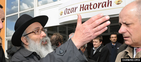 A distraught Chabad-Lubavitch Rabbi Yosef Matusof, who lost three students of his Gan Rashi elementary school in Monday's attack, seeks answers outside the Ozar Hatorah high school just meters from where they were slain. (Photo: Eric Cabanis/AFP/Getty)