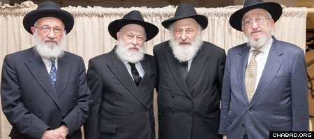 Rabbis Faivel Rimler, Yehuda Krinsky, Dovid Schochet and Shmuel Fogelman were among the 12 young men sent by the Rebbe, Rabbi Menachem M. Schneerson, of righteous memory, to console and strengthen the community in Kfar Chabad, Israel, in 1956. (Photo: Ran Shapira)
