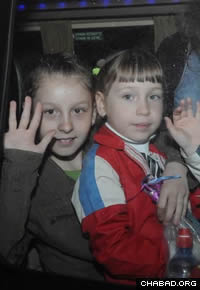 Two of 26 children brought to Israel by Chabad's Children of Chernobyl leave Ben Gurion International Airport.