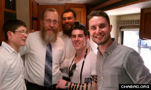 Rabbi Mendel Katzman, second from left, and crew celebrate Judaism with a couple of attendees of the annual Berkshire Hathaway shareholders conference.
