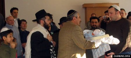 Members of Hanover, Germany's Jewish community celebrate the circumcision of a local baby boy. (File photo)