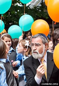 British Chief Rabbi Lord Jonathan Sacks attends the grand opening of the Lubavitch Children's Centre in 2010.