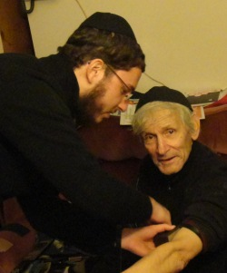 Me helping Alex into tefillin for the first time in his life.