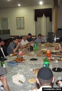 Students and teaches at Yeshiva Torah Ohr celebrate Adam Douglas' circumcision.