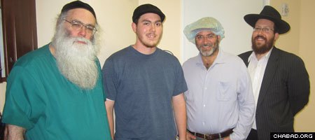 20-year-old Adam Douglas, second from left, poses with the team that presided over his circumcision in South Florida.