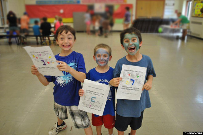 Camp Gan Israel of Orange County campers Arlo Stier, 8, and Noach Reich, 6, of Monroe have a blast studying the Hebrew alphabet with fellow camper Ethan Justin, 6, of Circleville.