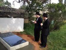 Praying at Miriam's grave.