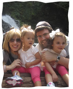 Rabbi Bruk with his wife Chavie and their two daughters.